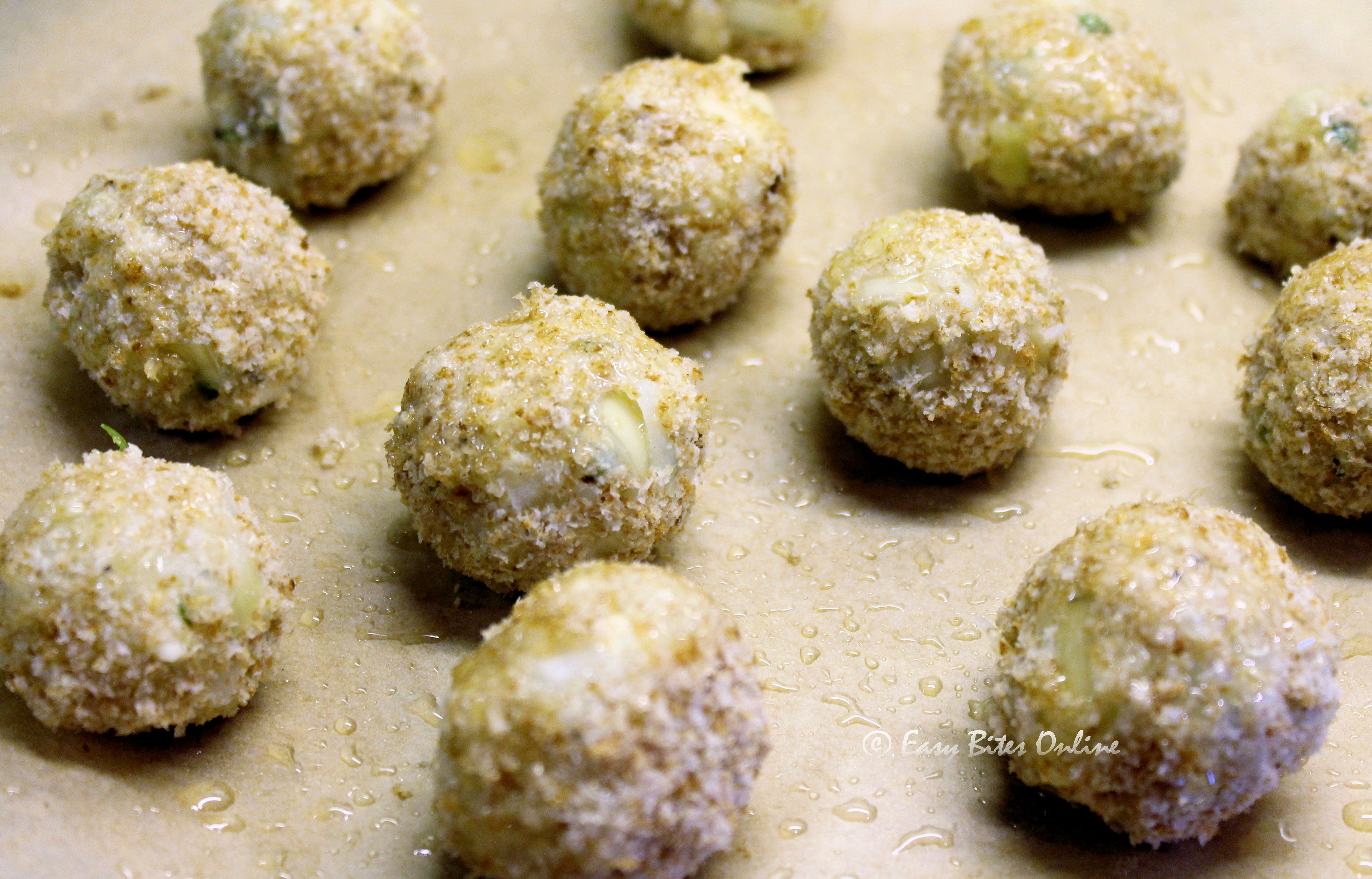 place the prepared balls over lined greased baking tray, bake at 190 deg C until golden