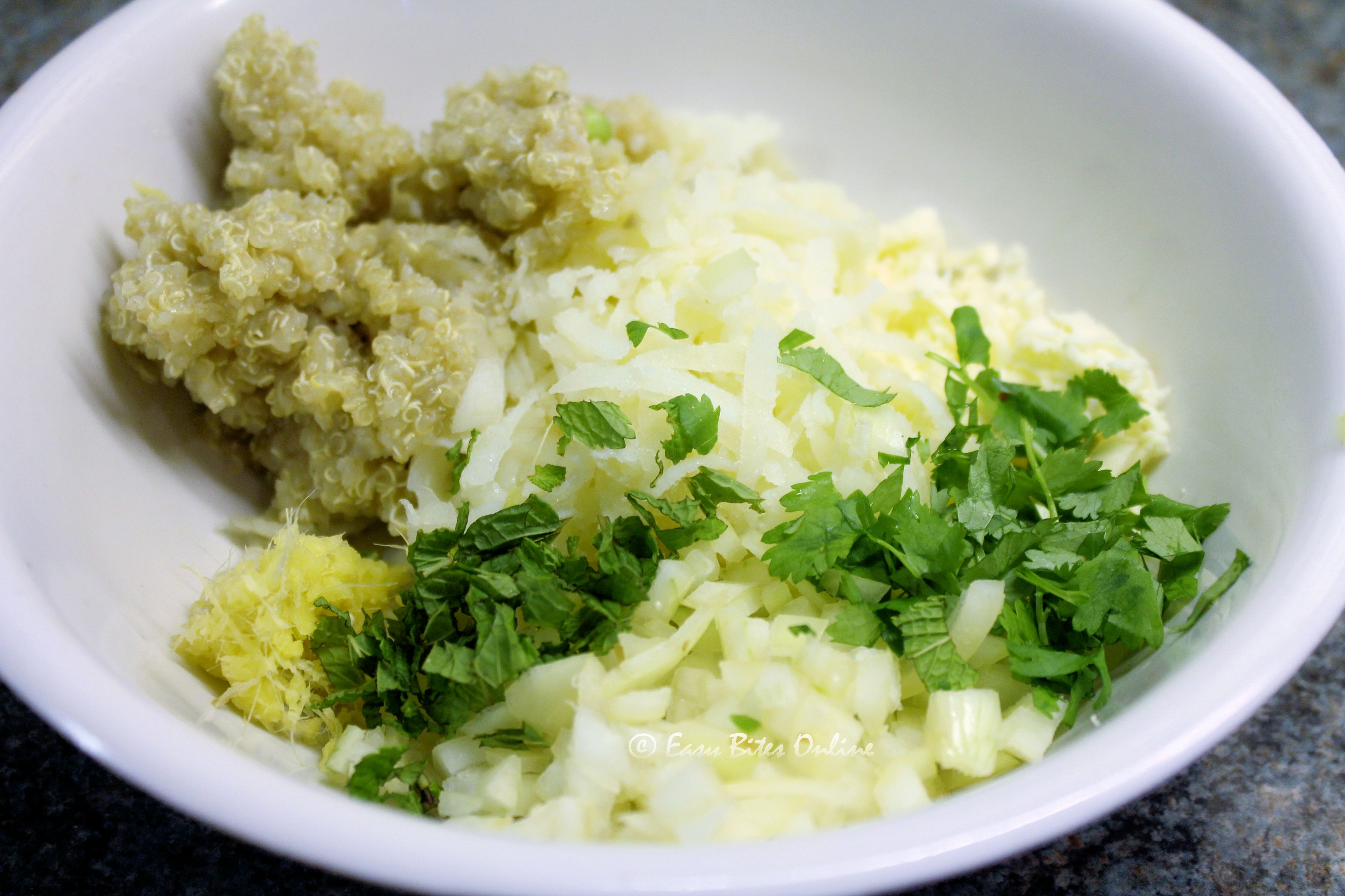add quinoa, potato, paneer, onion, ginger, garlic, salt and pepper to a bowl (1)